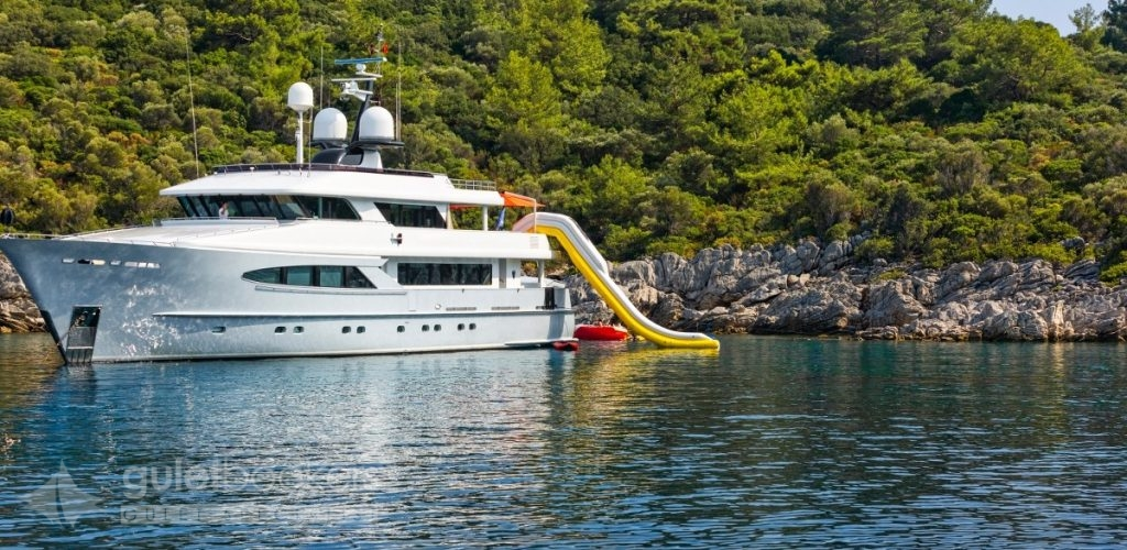 A luxury white motor yacht in the bay